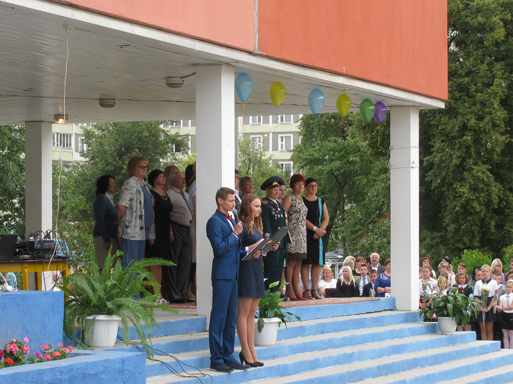 The opening of a celebratory assembly called Lineika. School children line up on the school quadrangle to listen to the welcome address by the headmaster and veterans.